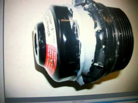 Removing a Toyota Corolla cartridge oil filter housing