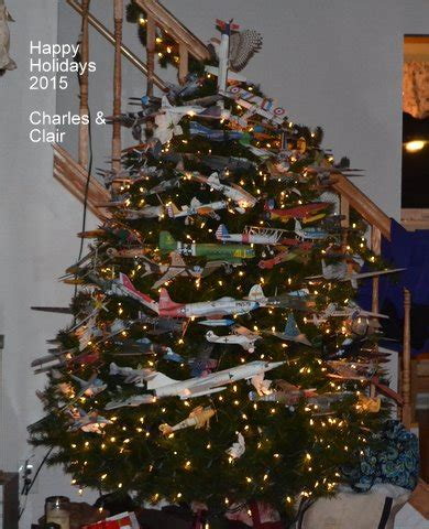 Christmas tree with paper model airplanes as ornaments by