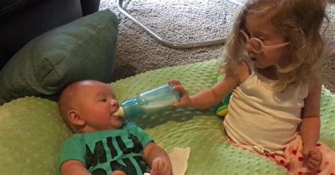 Big sister look after his baby brother