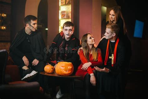 Guy In Count Dracula`s Halloween Costume Is Sitting With